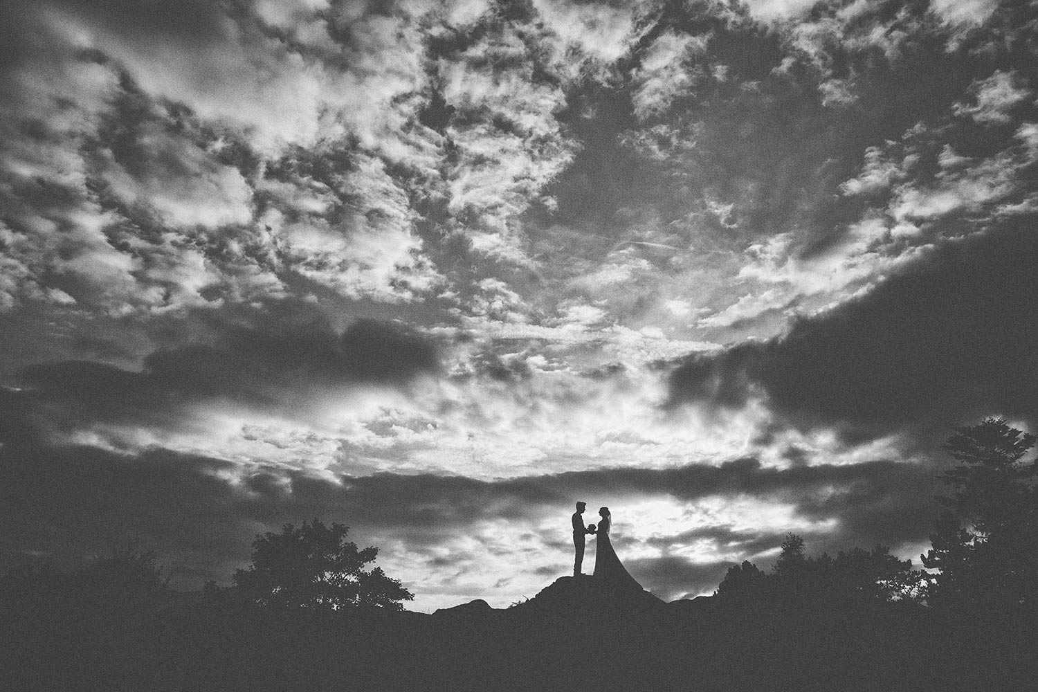 Bride and Groom with Lake District mountains and clouds